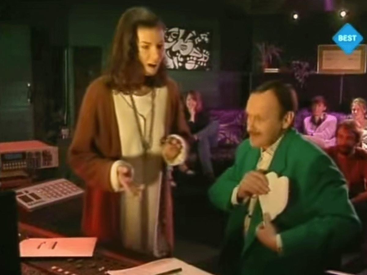 Jacek Cygan w zielonej marynarce, Edyta Górniak w białym swetrze