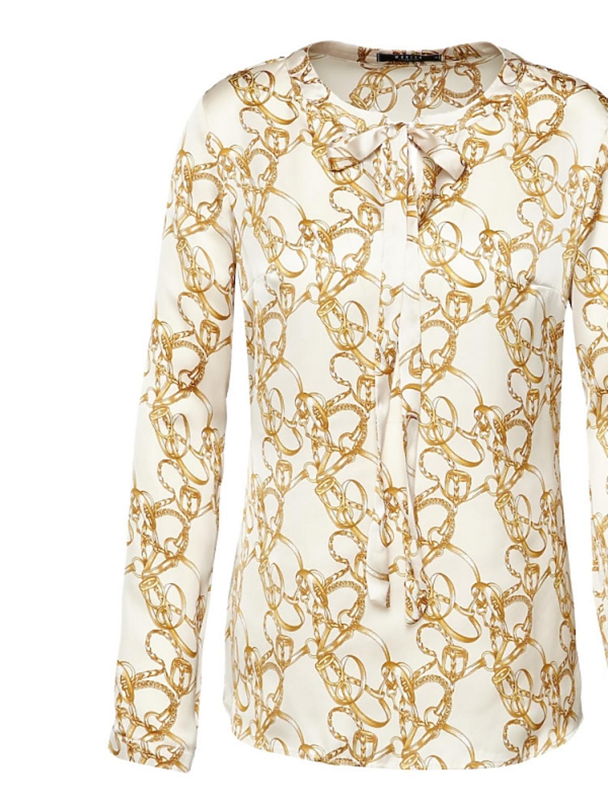 biała bluzka w kolorowe printy z wiązaniem