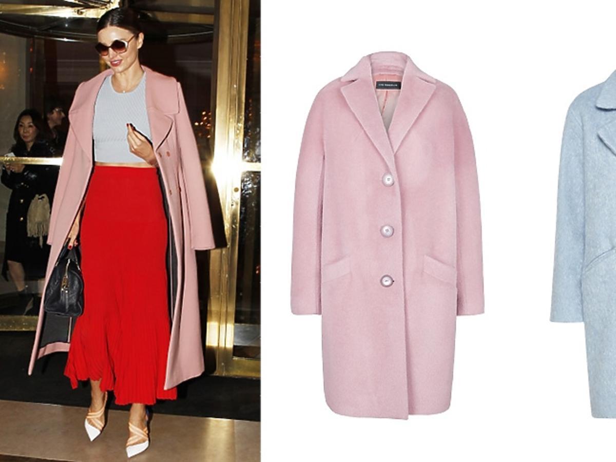 Miranda Kerr w różowym płaszczu , czerwonej długiej spódnicy, niebiskim topie, białych szpilkach, dużych okularach z czarnątorebką do ręki, niebiski pastelowy płaszcz