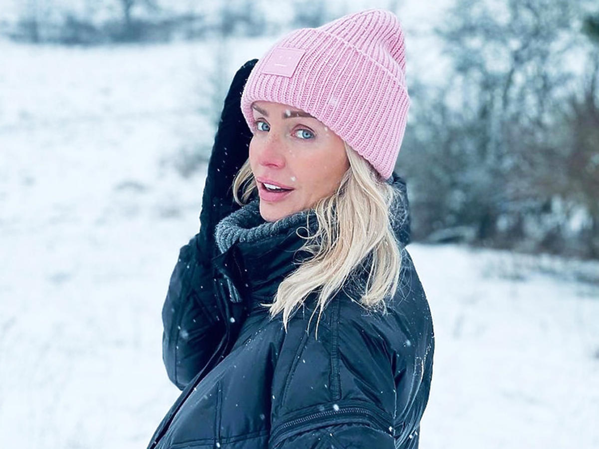 Agnieszka Woźniak-Starak w różowej czapce
