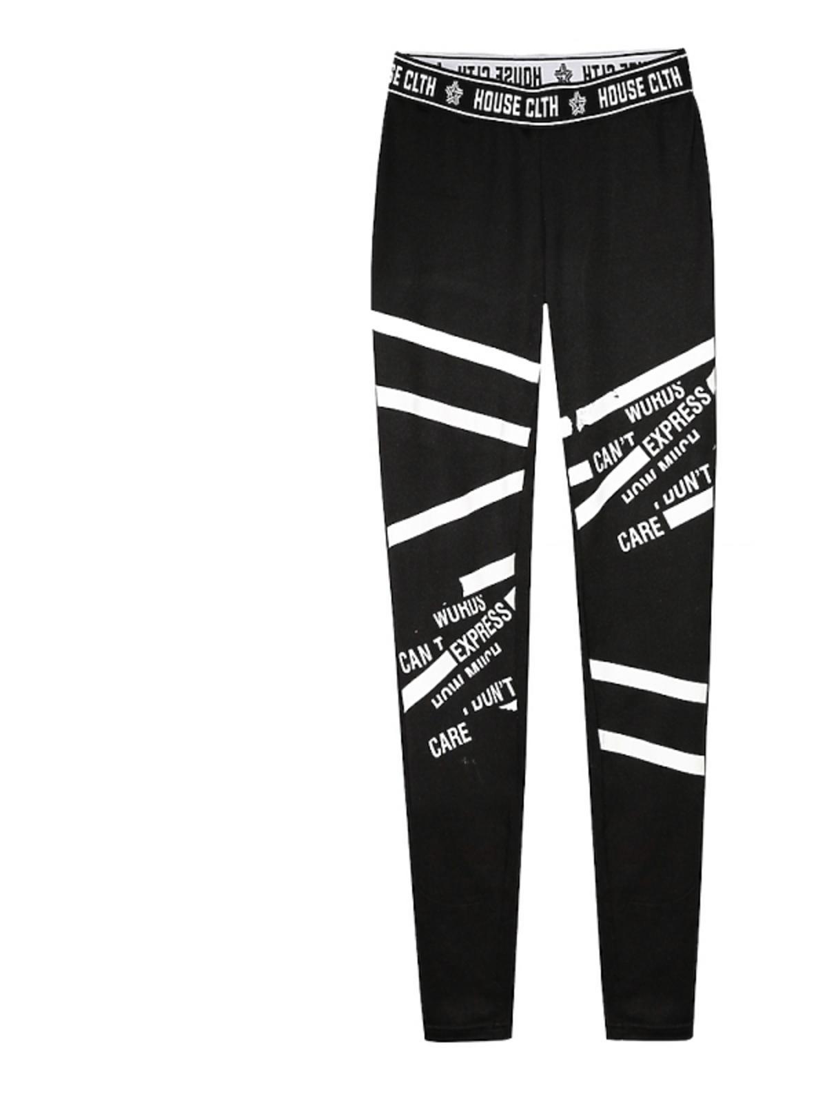 czarne legginsy w białe wzory i napisy