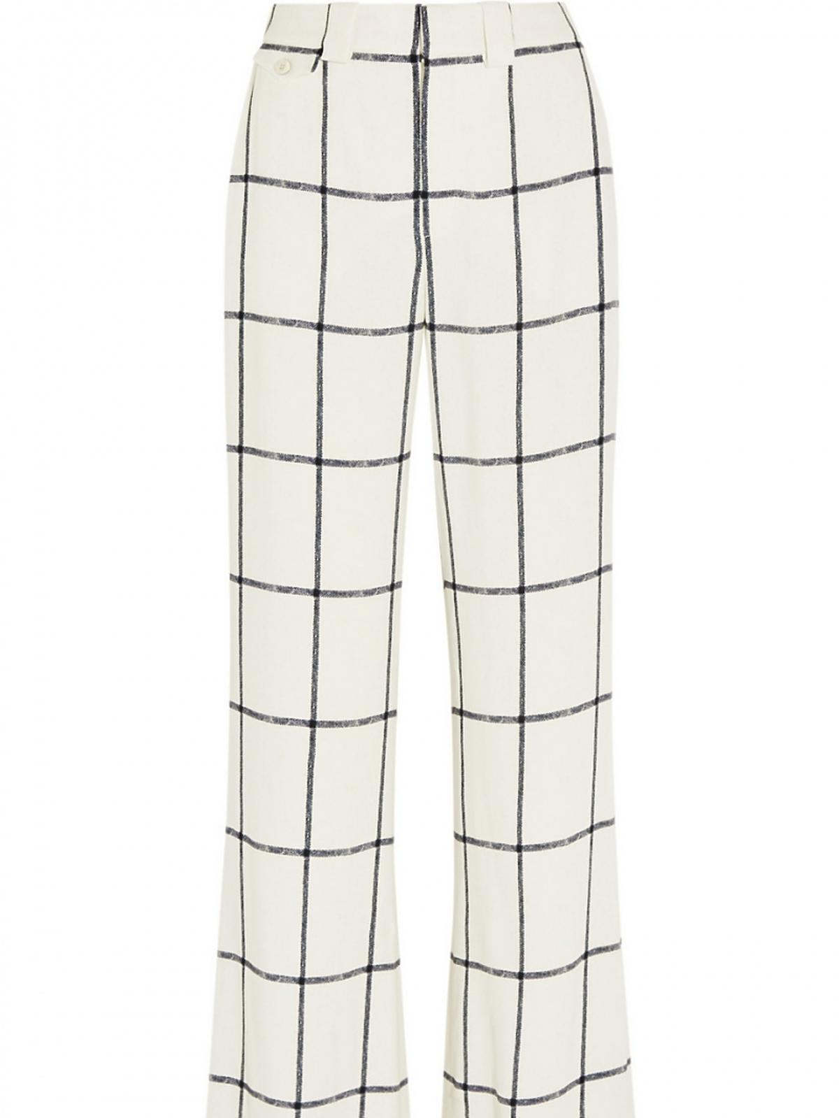 czarno-białe spodnie w kratę z szerokimi nogawkami