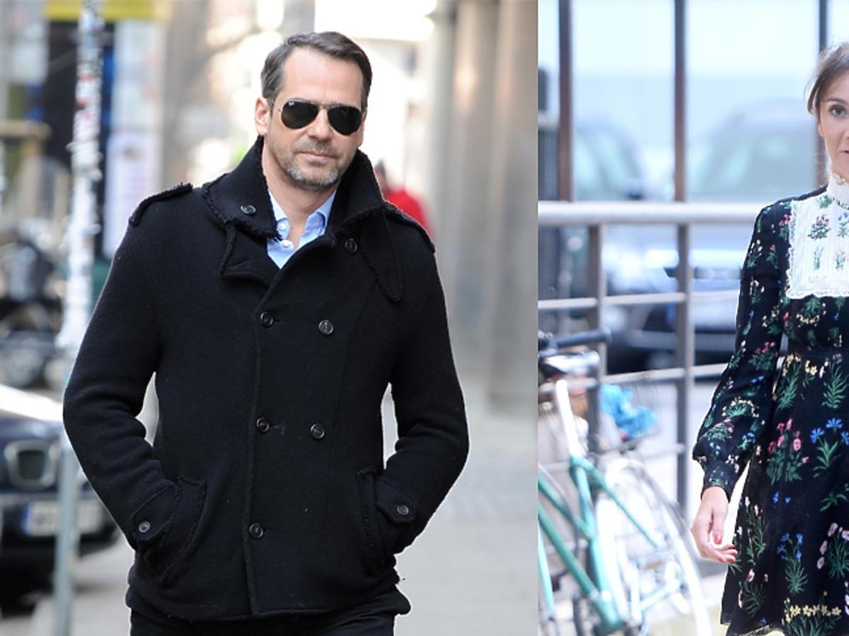 Dominika Kulczyk w sukience w kawiatki i Paweł Deląf w czarnej kurtce na ulicy