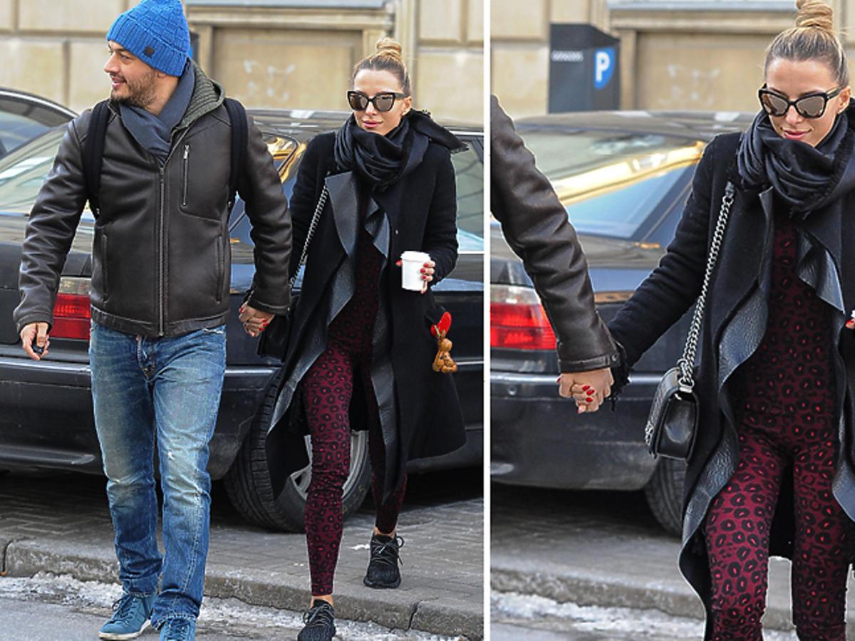 Ewa Chodakowska z mężem w kombinezonie sportowym i płaszczu