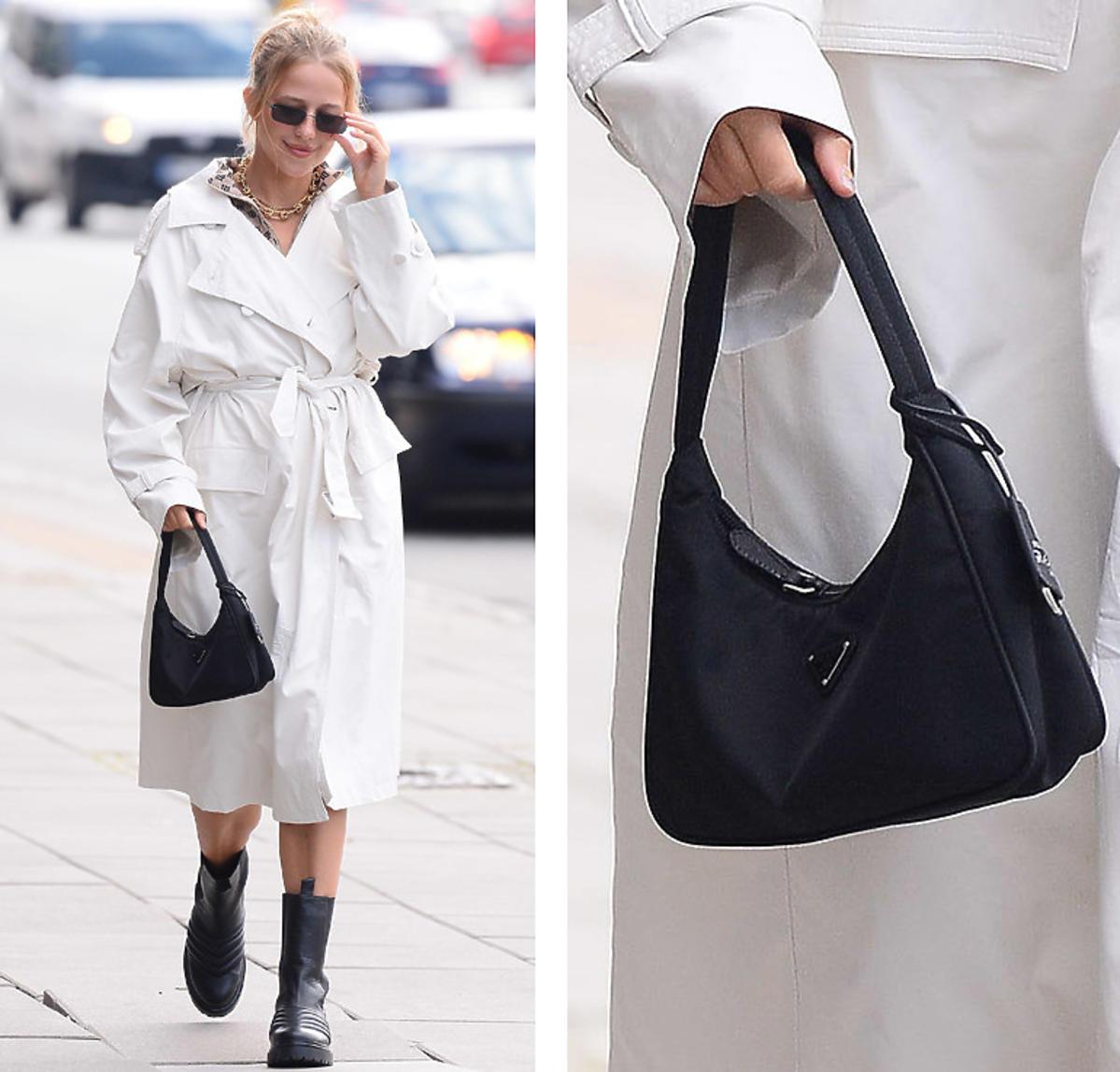 Jessica Mercedes w białym płaszczu i z czarną torebkę Prada