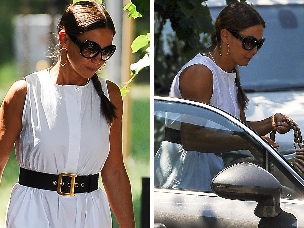 Kinga Rusin w białej sukience wsiada po Porsche w Warszawie