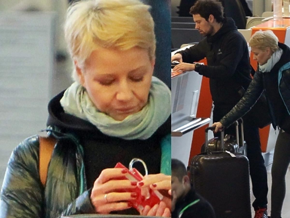 Małgorzata Kożuchowska i Bartek Wróblewski na lotnisku w Warszawie