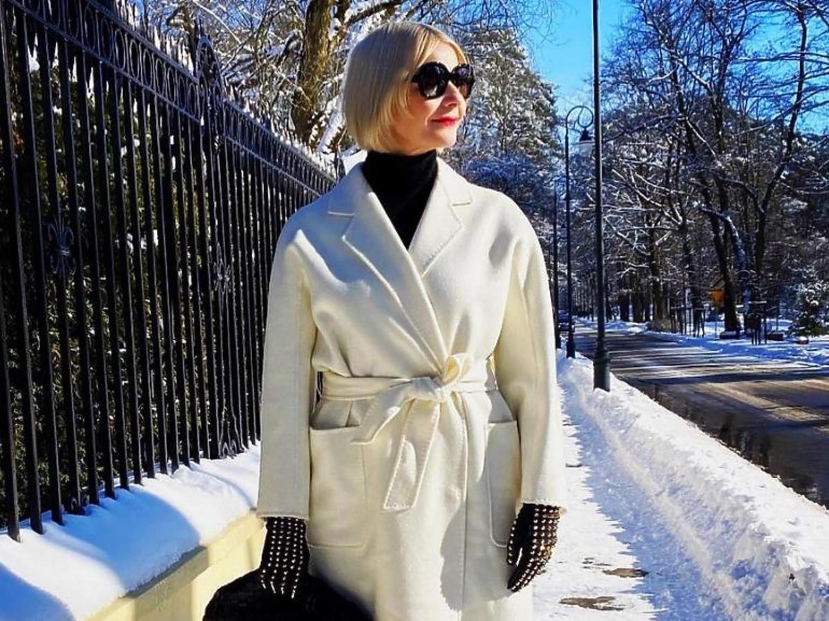 Małgorzata Kożuchowska w białym płaszczu