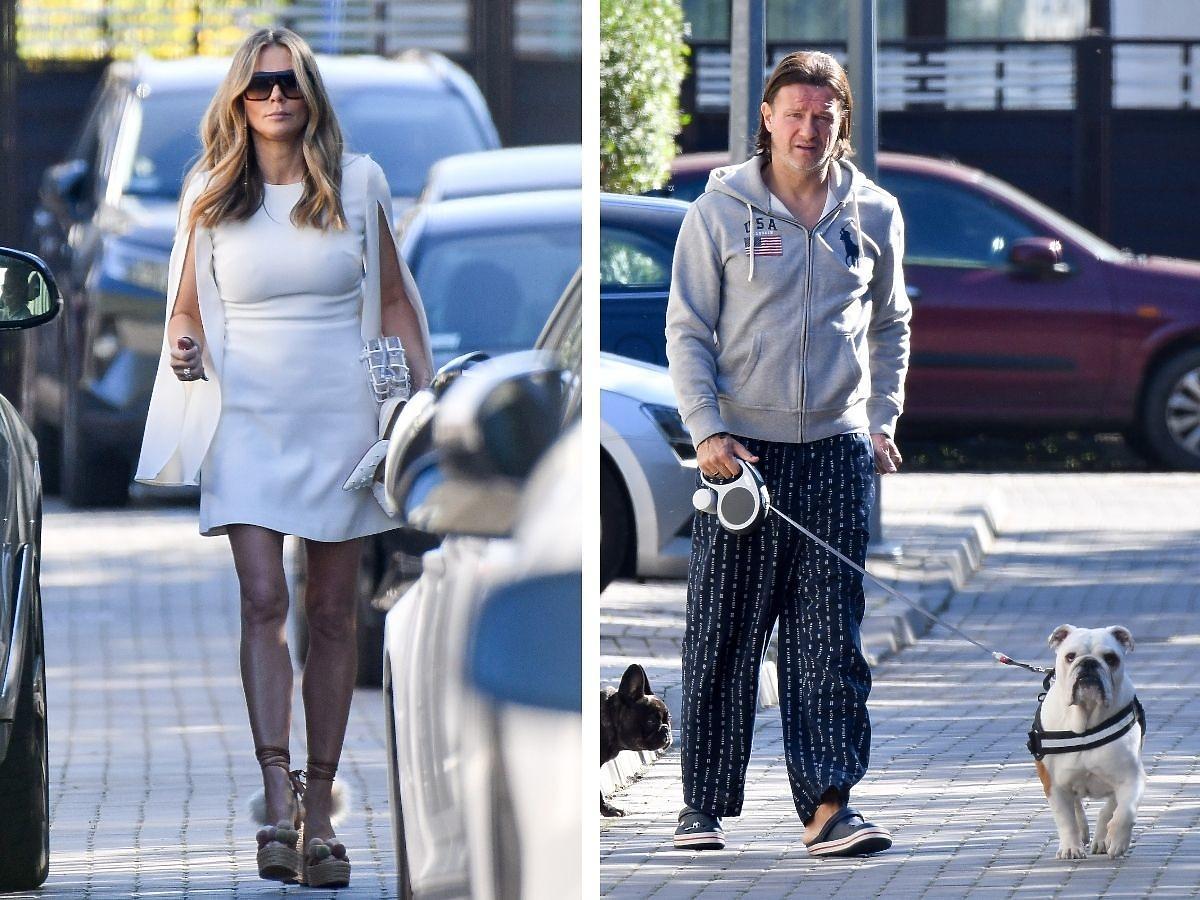 Małgorzata Rozenek w białej sukience i Radosław Majdan z psem na spacerze