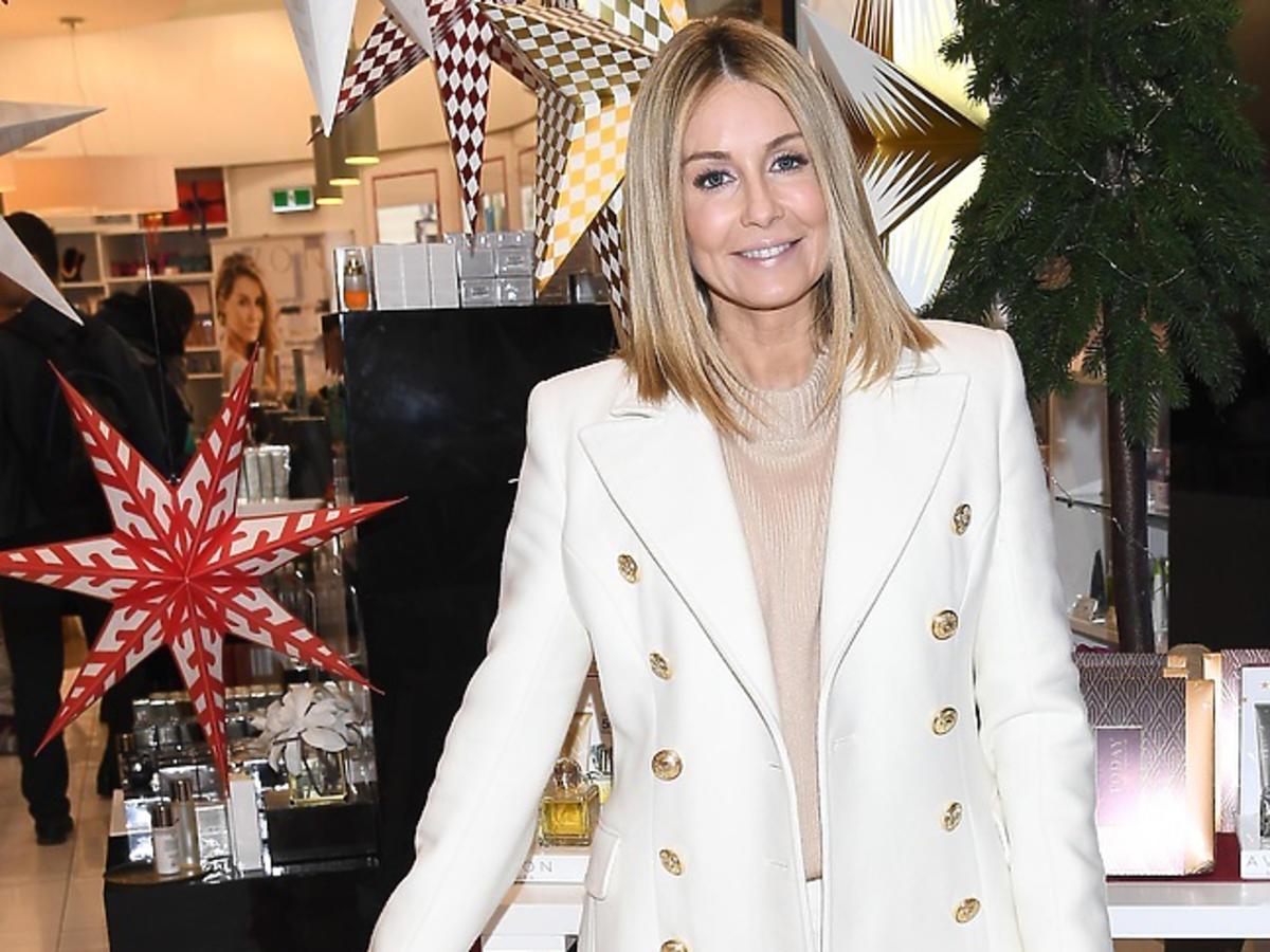 Małgorzata Rozenek w białym płaszczu w Złotych Tarasach