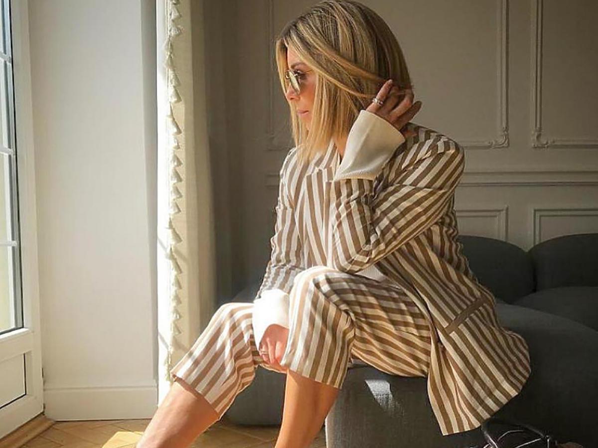 Małgorzata Rozenek w garniturze H&M i butach Ryłko