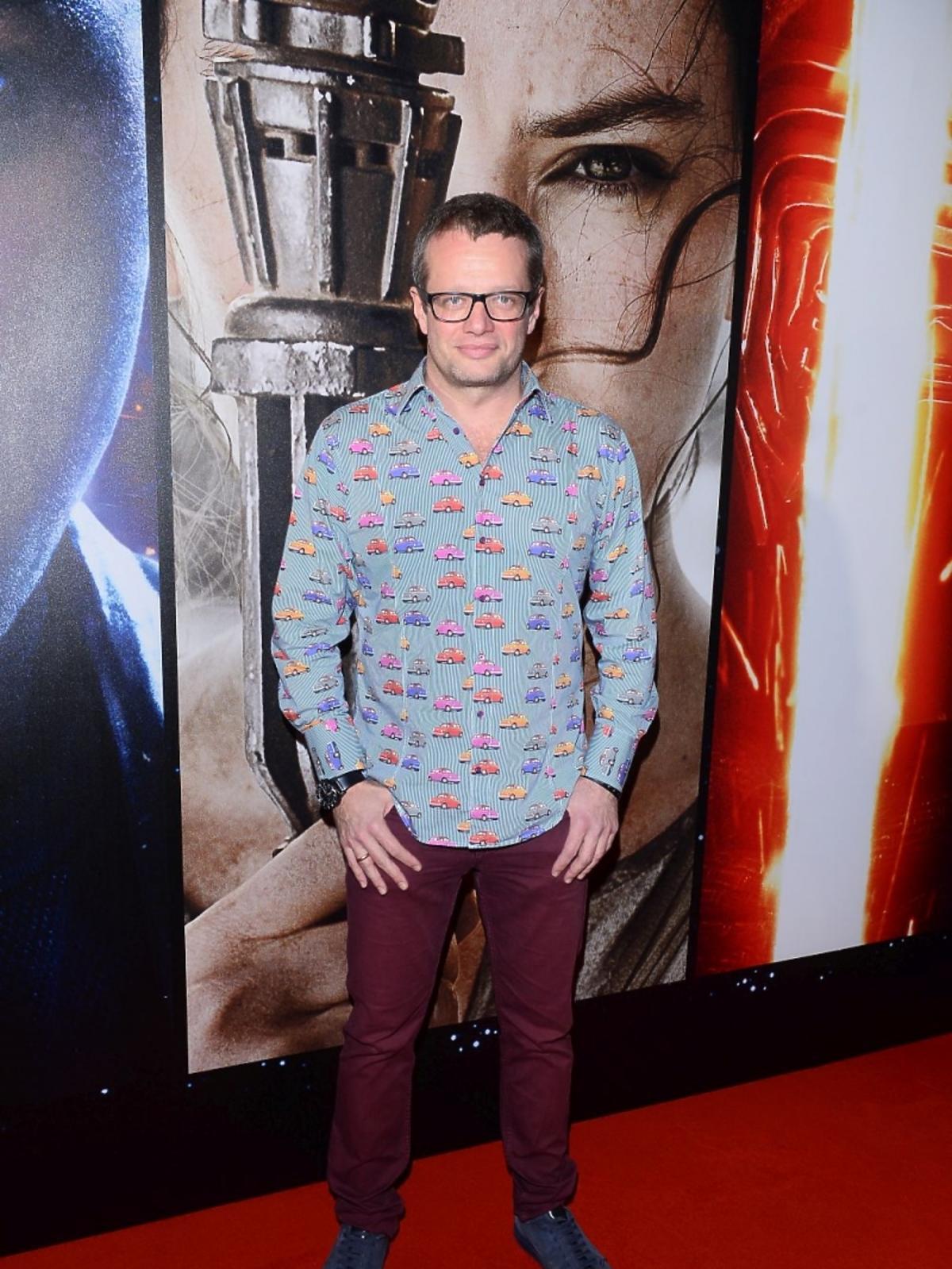 Marcin Meller w niebieskiej koszuli