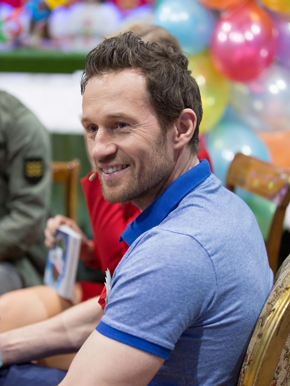 Mateusz Kusznierewicz w niebieskiej koszulce
