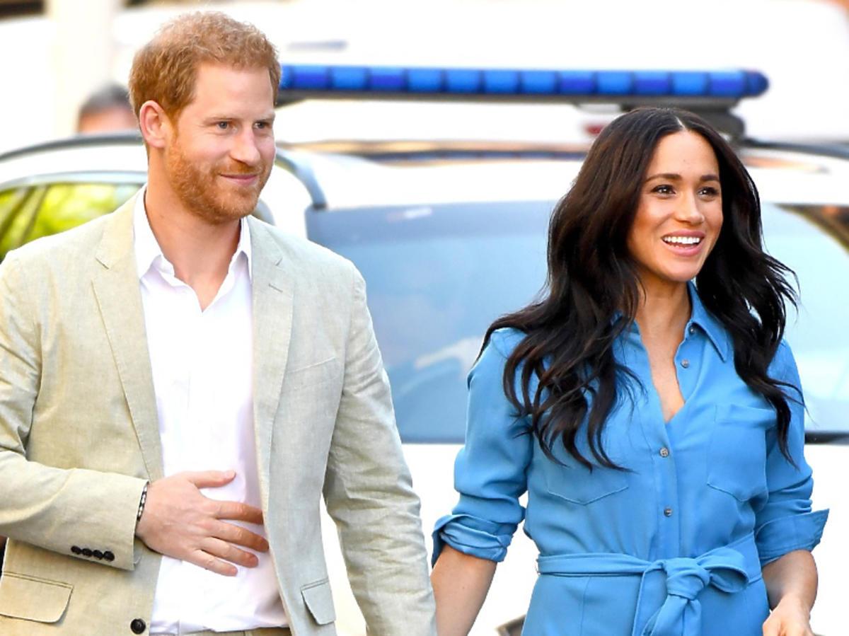 Meghan Markle, książęHarry trzymają sięza ręce