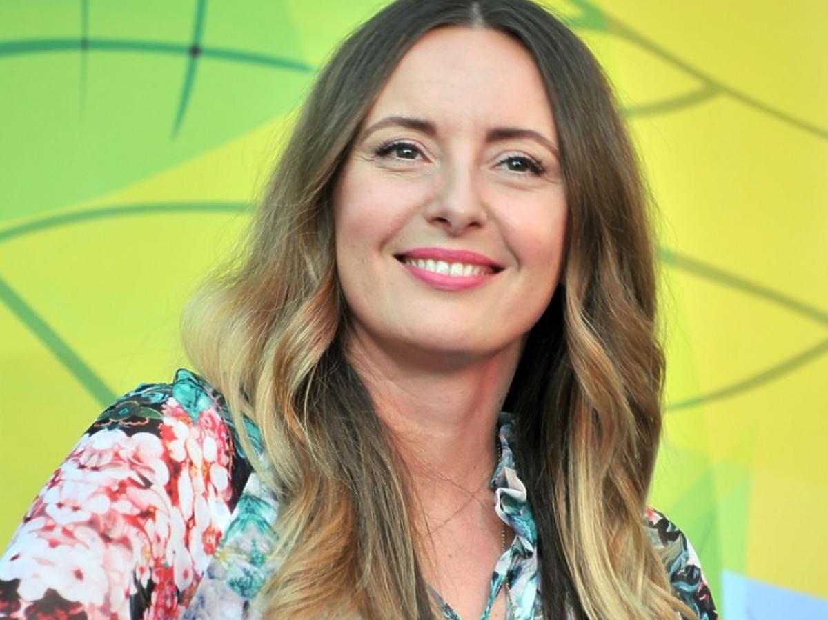 Monika Kuszyńska uśmiechnięta