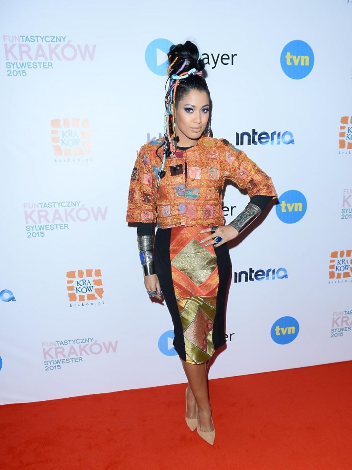 Patricia Kazadi w pomarańczowej sukience