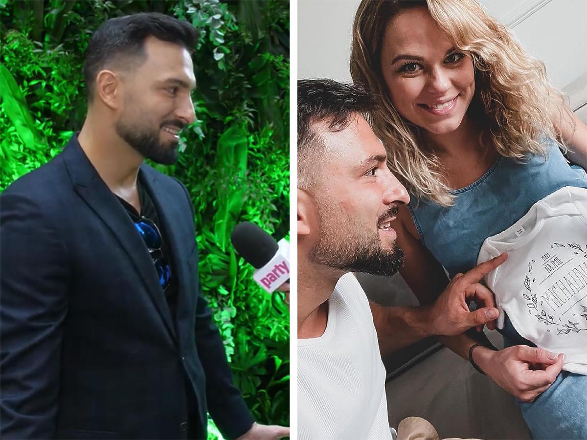 Rafał Maślak w ciemnym garniturze. Rafał Maślak z żoną Kamilą dotykają ciążowy brzuszek