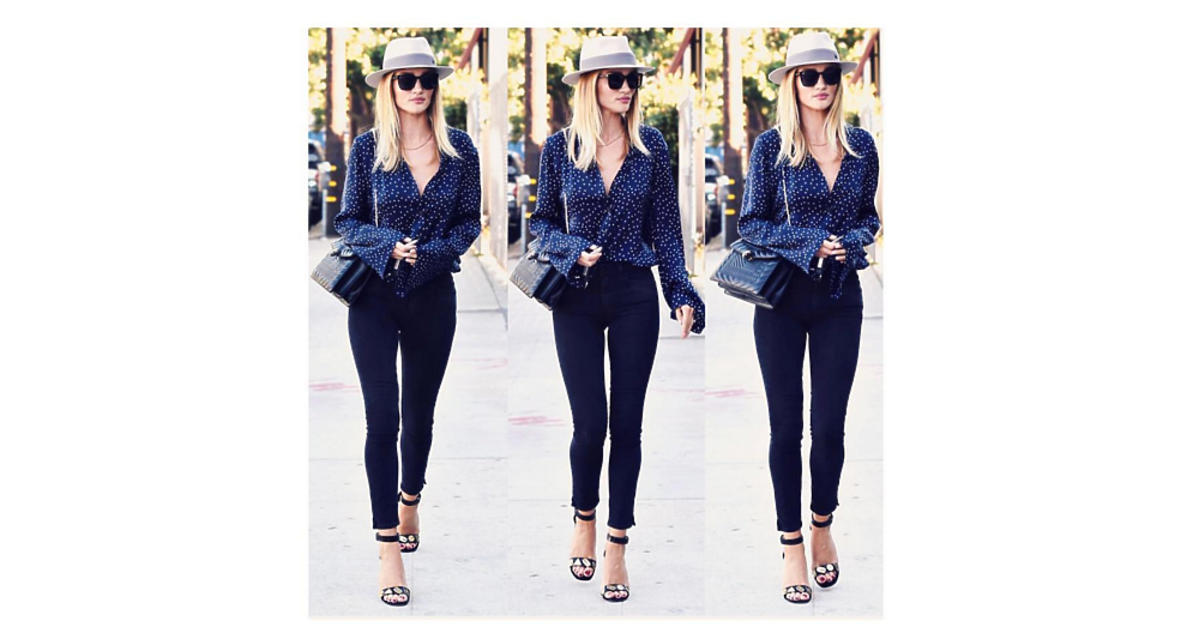 Rosie Huntington-Whiteley w dżinsach i ciemnej koszuli na ulicy