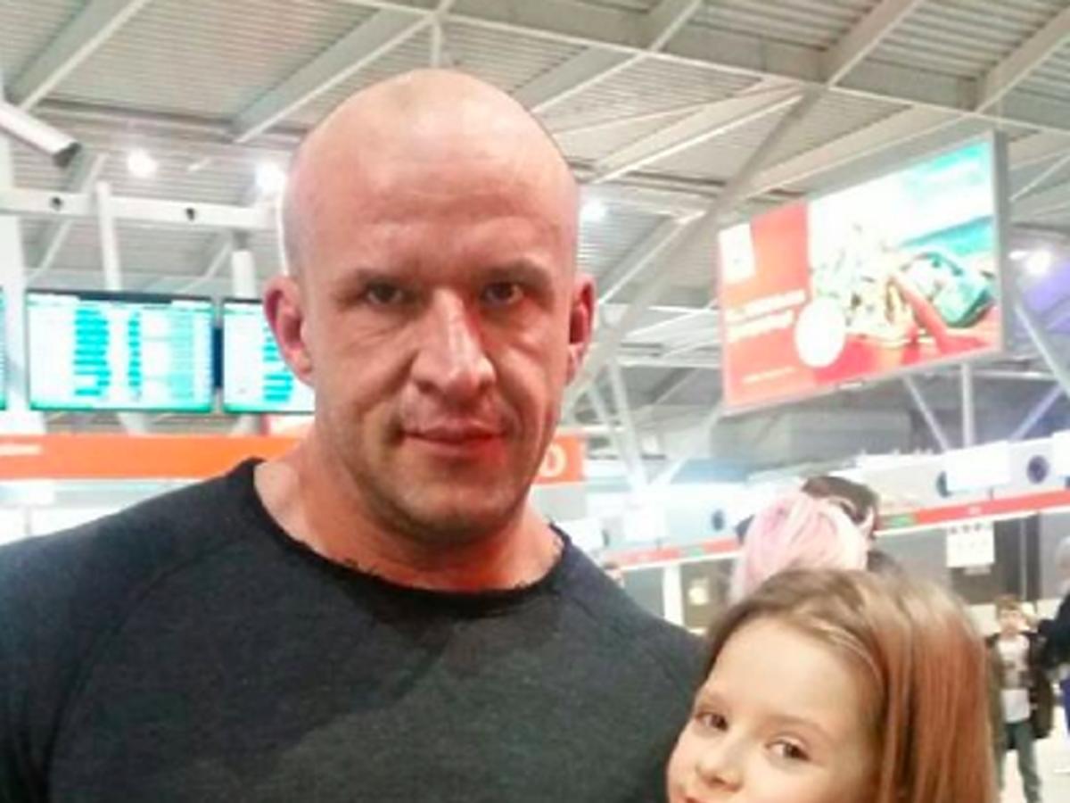 Tomasz Oświeciński z córką Mają