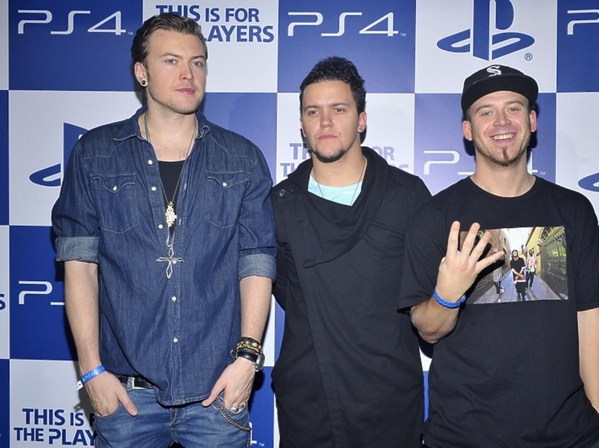 Wojciech Łozowski, Tomasz Torres i Tomasz Lach na premierze Playstation 4