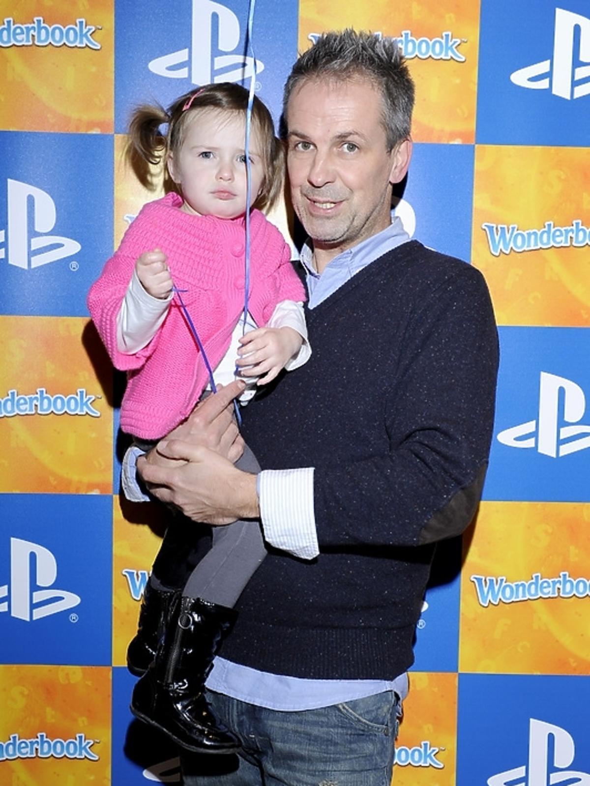 Zbigniew Urbański z córką na premierze PlayStation 3 - Wonderbook: Księga Czarów