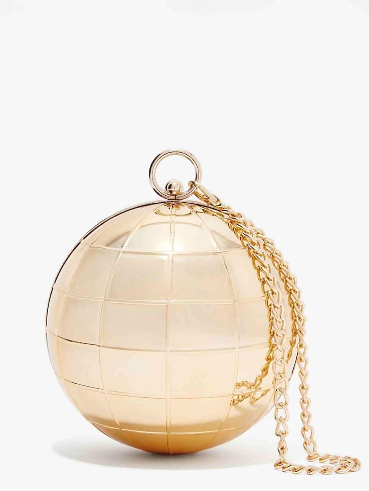 złota torebka w kształcie kuli