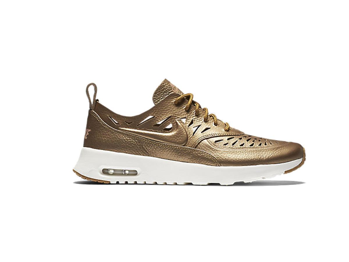 Złote buty sportowe